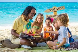 Beach nanny with kids on the beach